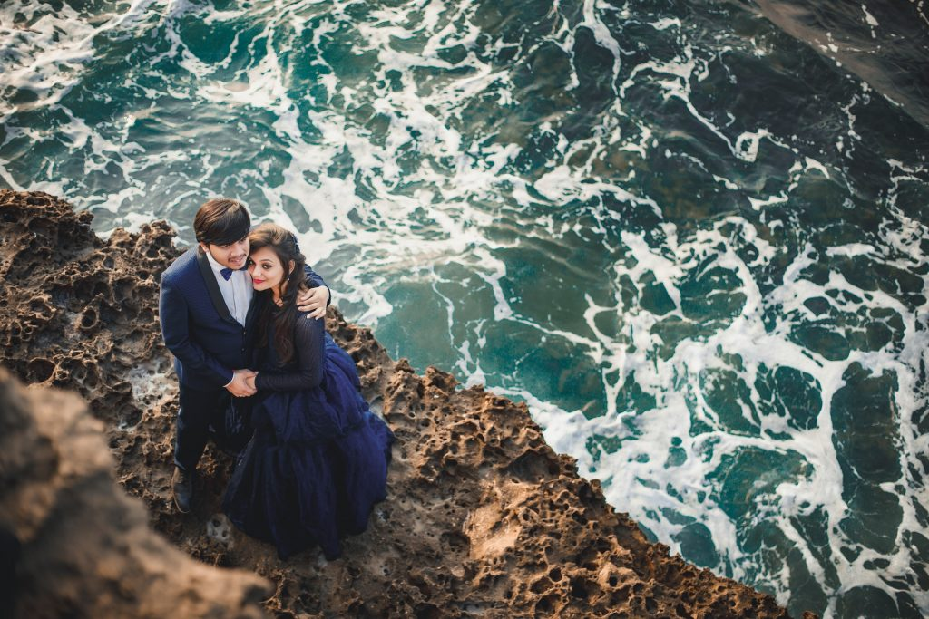 man-and-woman-standing-on-cliff-2174664